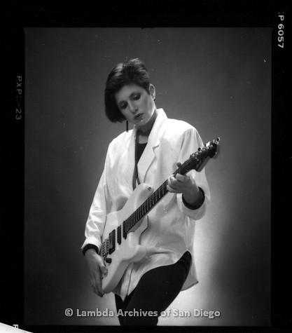 1988 - San Diego Native, Zanne in white blazer with white guitar, studio portrait.