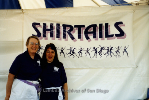 San Diego Pride Festival, July 1992: Partners Sheila Clark (left) with Judy Reif (right) members of San Diego Women's Chorus in front of Shirtails Dances booth.