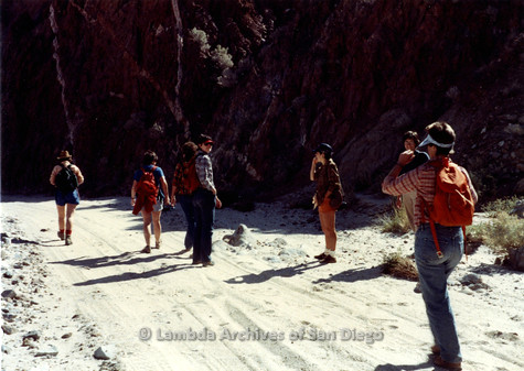 P008.091m.r.t Laguna Mountains 1984: Group walking on sandy trail