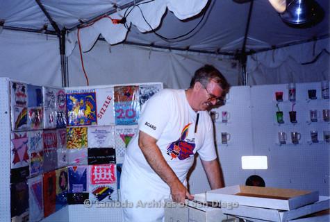P018.128m.r.t San Diego Pride Festival 1994: Doug Moore setting up Lambda Archives tent