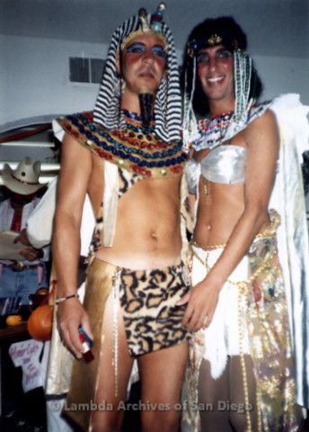 "P243.099m.r.t ""Being Alive"" Halloween Party in Hillcrest: Two men dressed in King Tut and Cleopatra costumes"