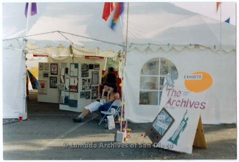 P200.013m.r.t San Diego Pride Festival 1992: Lambda Archives tent with Jules Wertis (right) and friend sitting inside