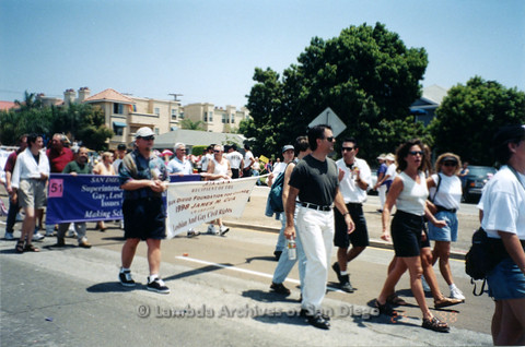 P122.006m.r.t Pride 1998: Photo of Superintendent's Committee on Gay, Lesbian, & Bisexual Issues in Education and 1998 James M. Cua supporters marching.