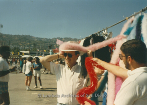 P018.004m.r.t San Diego Pride Festival 1985: Men trying on hats