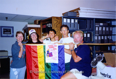 P018.129m.r.t San Diego Pride Festival 1994: (L to R) Sharon Parker, Laura Opfer, Robert Nguyen, Frank Nobiletti, and Jim Oberle holding flag after clean up of exhibit
