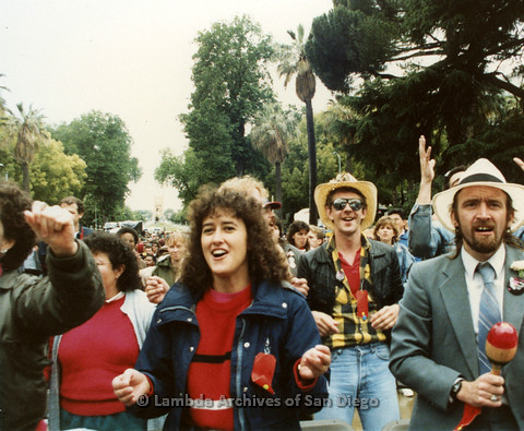 P019.148m.r.t March on Sacramento 1988 / Pre Parade gathering: Closer shot of some people in audience