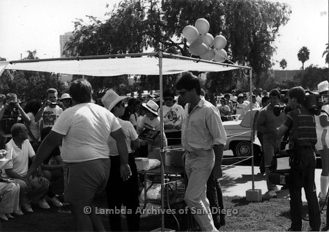 P116.023m.r.t San Diego Walks For Life 1986: People and reporters gathered under and around canopy