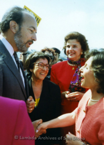 P341.032m.r.t Dianne Feinstein and Barbara Boxer talking with unidentified man and woman