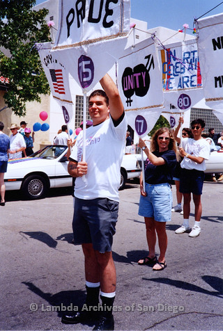 P018.116m.r.t San Diego Pride Parade 1994: Dan Stiteler holding Lesbian and Gay Archives banner