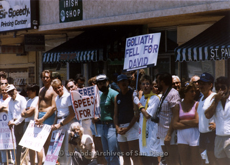 San Diego Lambda Pride Parade: The Parade Crowd holding Pro-LGBT signs across the street from Fundamentalist Christian Protesters. The Signs Read, 'Goliath Fell For David', 'Free Speech For All', 'Thanks for Marching With Us' and 'Love