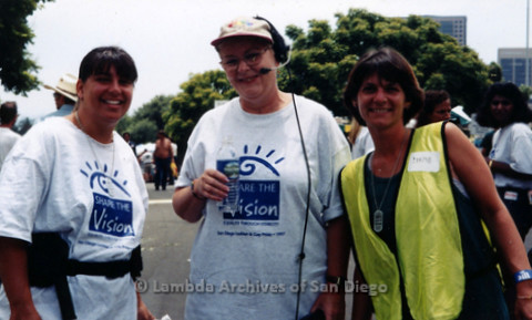 """P119.065m.r.t San Diego Pride 1997: Three women standing outside, two with """"Share the Vision"""" t-shirts"""