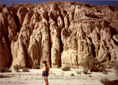 P008.080m.r.t Anza-Borrego Desert 1984: Sandy Johnson in front of some tall cliffs