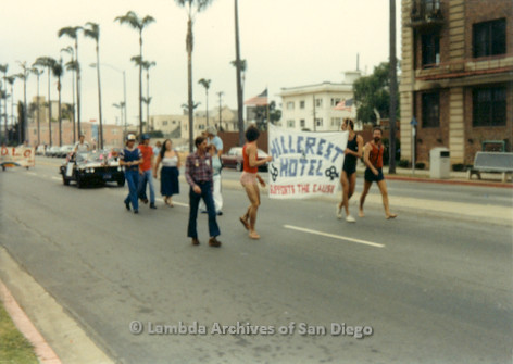 1982 - San Diego Lambda Pride Parade, 'Hillcrest Hotel' Contingent holds banner that reads: Hillcrest Hotel Supports The Cause.