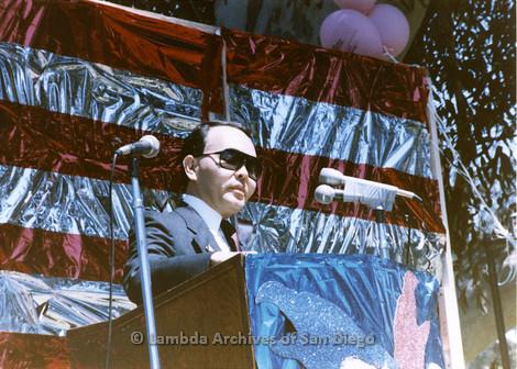 1985 - San Diego Lambda Pride Rally, Presentation of County Proclamation: Nicole Murray Ramirez speaking at the Pride Rally Podium in Balboa Park.