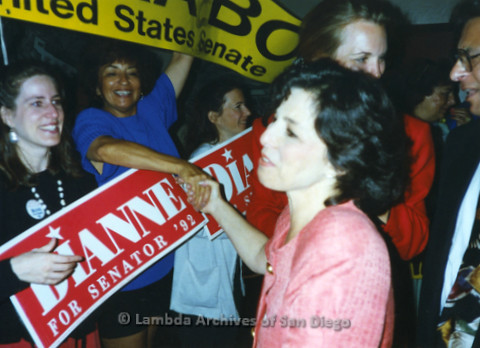 "P341.030m.r.t Barbara Boxer shaking hands with a woman holding a ""Dianna for Senator '92"" campaigne sign"