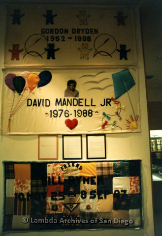 P019.080m.r.t AIDS Quilt at San Diego Golden Hall 1988: Three different quilts dedicated (top to bottom) to Gordon Dryden, David Mandell Jr, and Bill Rymer