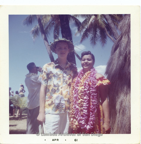 P338.092m.r.t Young Charles McKain on vacation in Hawaii standing next to a Hawaiian girl