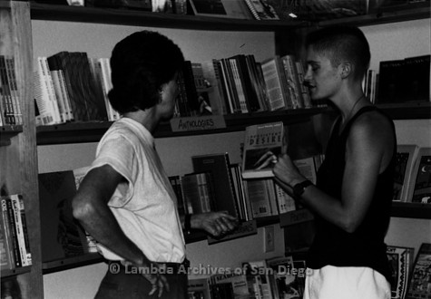P167.096m.r.t Paradigm Women's Bookstore: Karen Merry helping a customer find a book