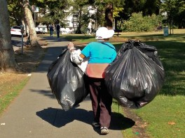 A woman working as a trash collector in suburbian America.