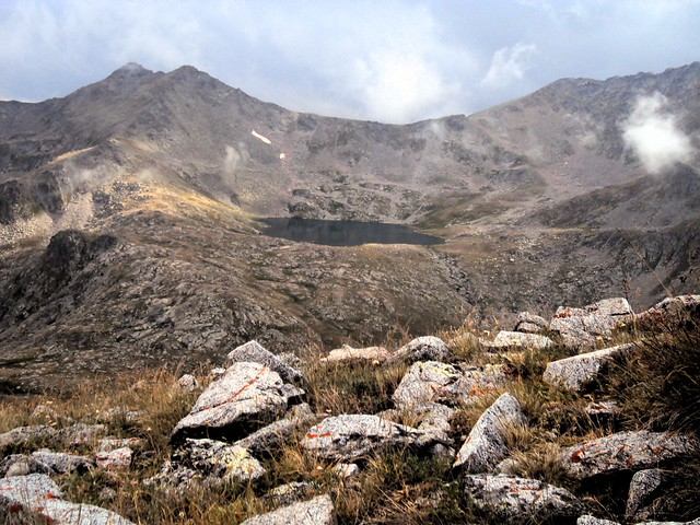 The pass above the lake is the one we came down the day before in the rain. by bryandkeith on flickr