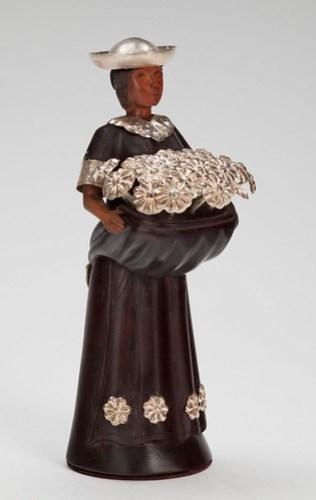 Sculpture of a Flower Vendor
