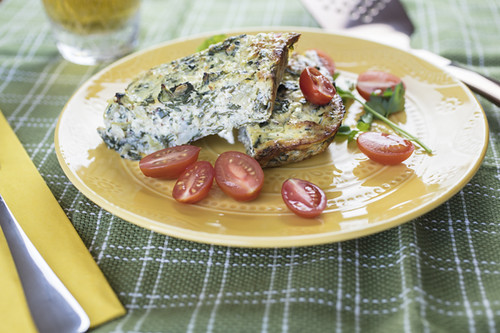 Crustless Chard Quiche Served With Tomatoes