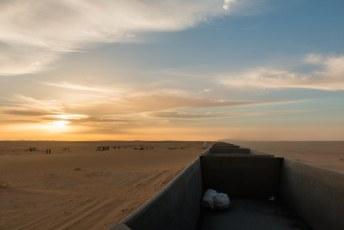 De zonsopkomst was spectaculair, vooral na een nogal oncomfortabele nacht in een wagon van de ijzerertstrein.