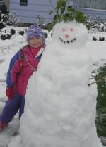 Nina with snowman