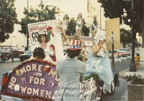 P024.083m.r.t Myth California Protest, San Diego, June 1986: women in costumes on a float