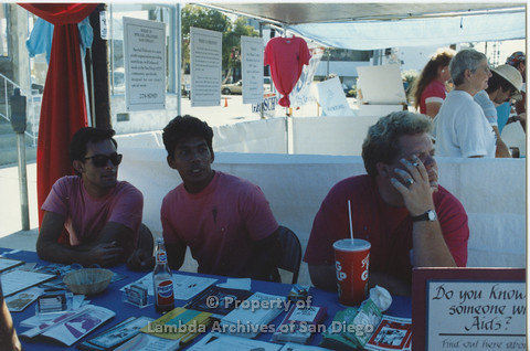 P001.100m.r  City Fest 1991: 3 AIDS Foundation San Diego vollunteers in booth