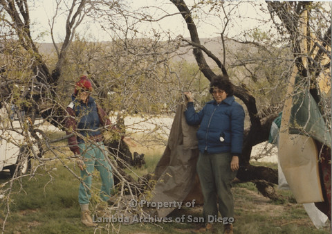 P024.072m.r.t Cathy Moore's 34th Birthday, Halley's Comet Weekend, Anza Borrego Desert 1986: 2 people behind a tree, one holding pieces of a tent