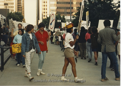 P024.124m.r.t Myth California Protest, San Diego, June 1986: shot of people marching