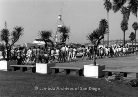P116.045m.r.t San Diego Walks For Life 1986: Walkers going down embarcadero past a yacht
