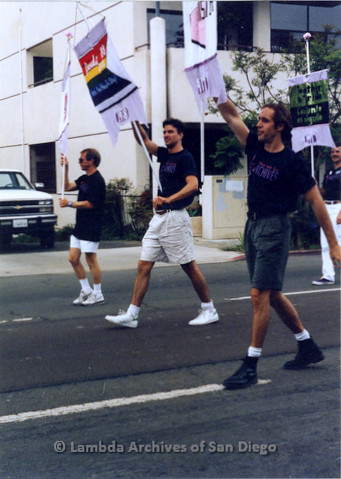 P018.053m.r.t San Diego Pride Parade 1990: (L to R) John Richardson, Glen Dake, and Jim Ely with banners