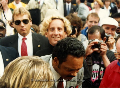 P019.131m.r.t March on Sacramento 1988 / Pre Parade gathering: Jesse Jackson standing in crowd of people