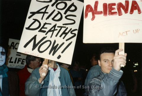 """P019.358m.r.t Los Angeles """"Die In"""" 1988: People holding signs, one reads: """"STOP AIDS DEATHS NOW! ACT UP/LA"""""""