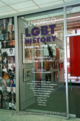 "P119.052m.r.t LASD City Hall Exhibit 2010: A sliding door with ""San Diego LGBT History"" exhibit information"