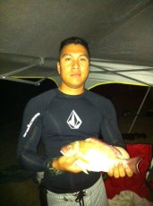Fishing fun on Fathers Day! Garrit with his catch of the day.... Toʻau