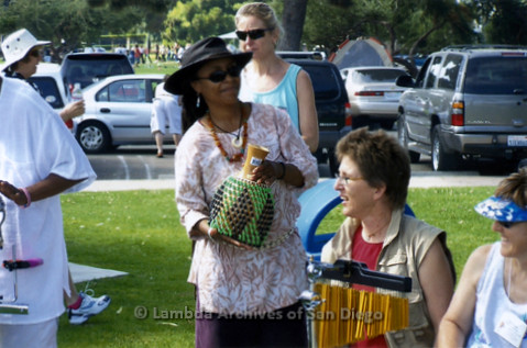 San Diego Women's Chorus (SDWC) hosts National Sister Singers Music Festival 2006: 'SDWC' hosts a welcome picnic at Mission Bay Park for the visiting Women's Choirs. Women from a Druming group arrive with drums and shekere gourd instrument.