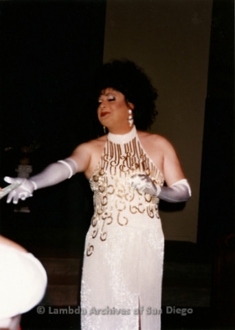P198.017m.r.t Activists in Drag fundraiser for TransNation: Russell Roybal singing in drag at the Metropolitan Community Church