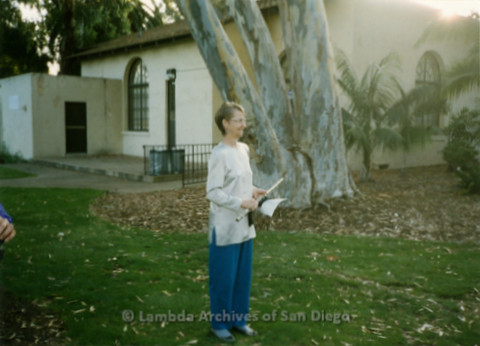 P198.006m.r.t GLAAD Sponsored Commitment Ceremony: Sharon Parker holding flute and sheet music outdoors in Balboa Park