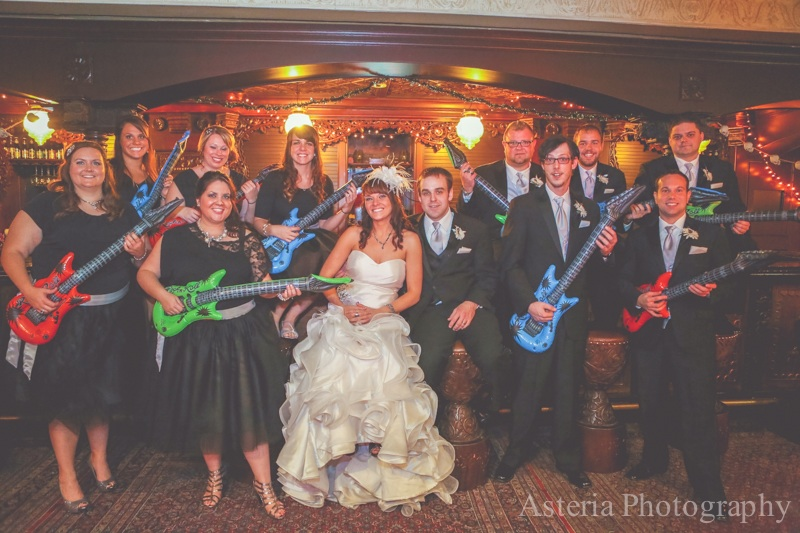 Wedding party photo with inflatable guitar props!