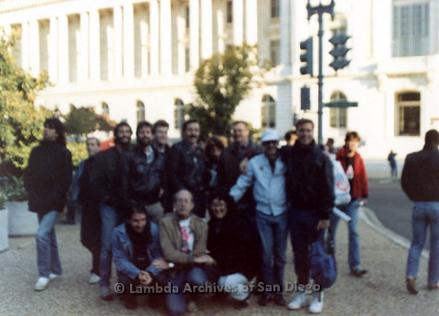 P019.256m.r.t Second March on Washington 1987: Group outside Capitol Building, Jess Jessop with brown jacket and white t-shirt (center)
