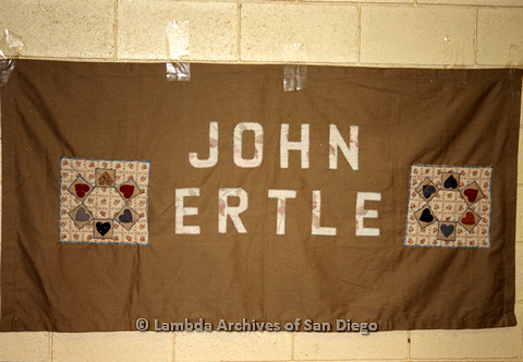 P019.053m.r.t AIDS Quilt at San Diego Golden Hall 1988: Brown quilt dedicated to John Ertle