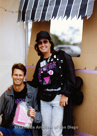 P018.183m.r.t San Diego Pride Festival 1990s: Bruce Kamerling and Laura Opfer outside Lambda Archives booth