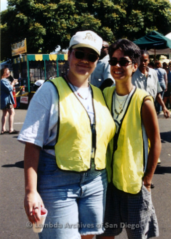 P119.068m.r.t San Diego Pride 1997: Two women wearing fluorescent safety jackets