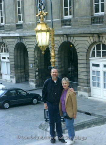 P338.079m.r.t Charles McKain standing with unidentified woman in Paris under a yellow street lamp