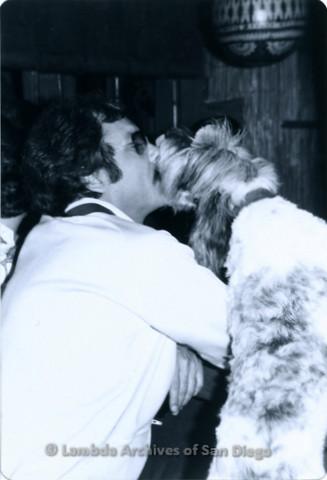 P355.056m.r.t Boom Boom Room Laguna Beach: Man kissing dog at the bar