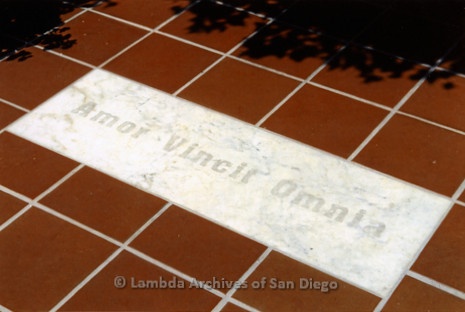 "P249.022m.r.t First Same Sex Weddings in San Diego: Plaque on ground tiles reads ""Amor Vinvit Omnia"""