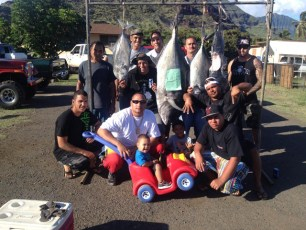 """Baba Holbron ,  Josh Kuhns and family. Winners of the """"Hook um and Cook um"""" Ulua tournament."""